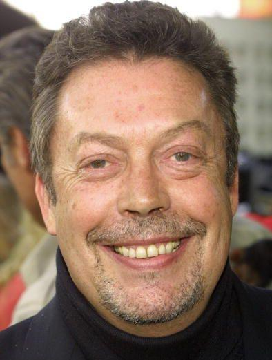 tim curry smiling