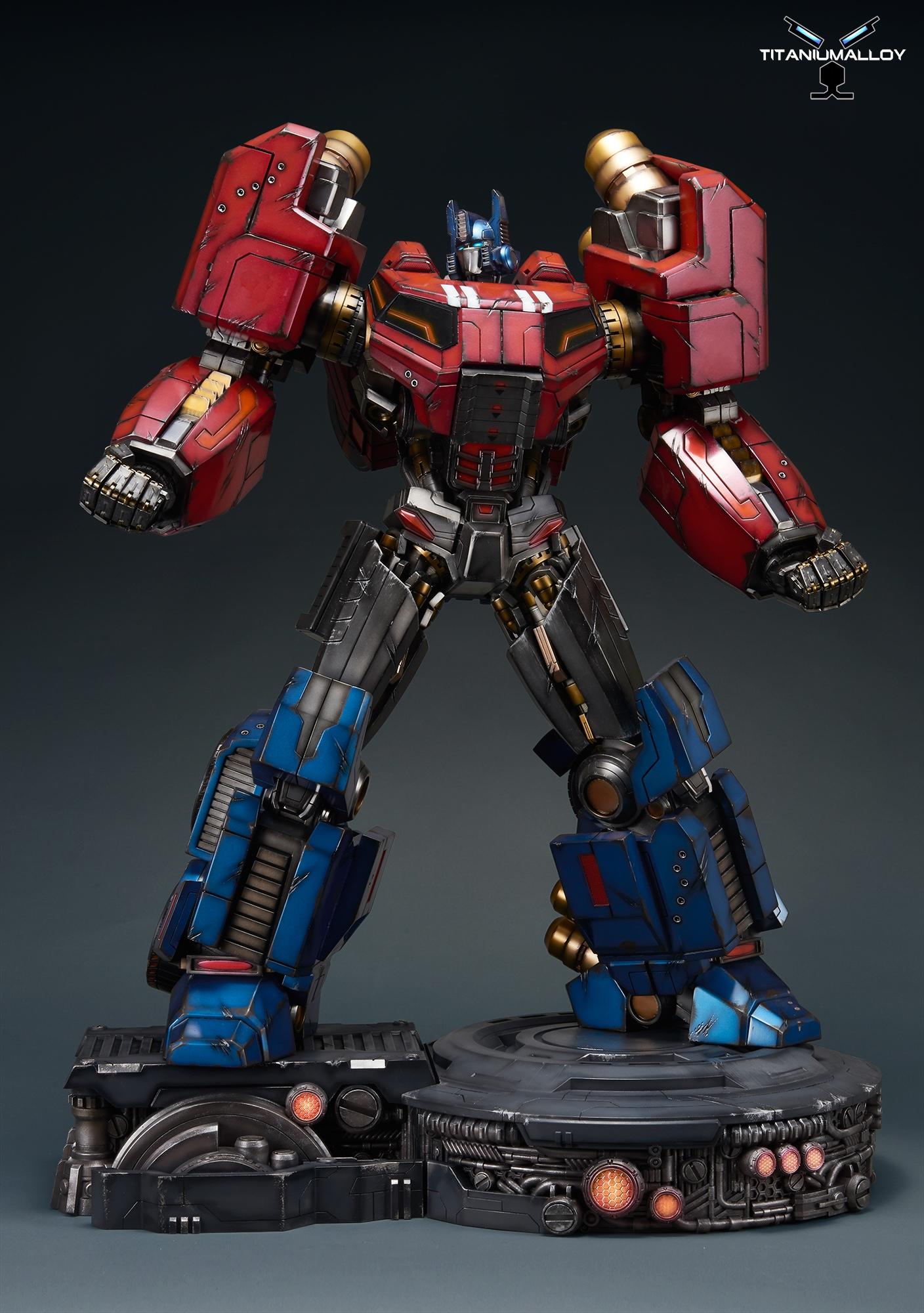 titanium alloy fall of cybertron optimus prime statue
