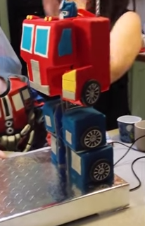 Incredible Fully Transformable Optimus Prime Birthday Cake Transformers Funny Birthday Cards Online Alyptdamsfinfo