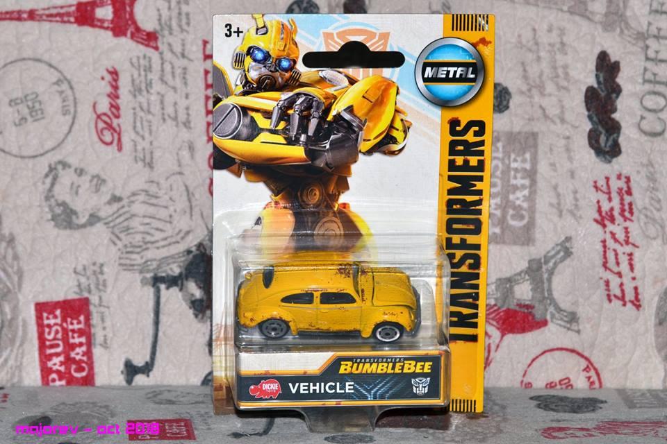 simba dickie transformers bumblebee   die cast volkswagen beetle  hand images